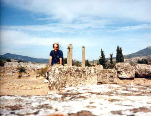Nate sits among the ruins in Nemea, Greece