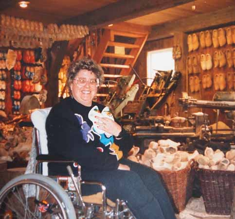 In wheelchair Nancy and Nate collect wooden shoes in Netherlands (Holland)