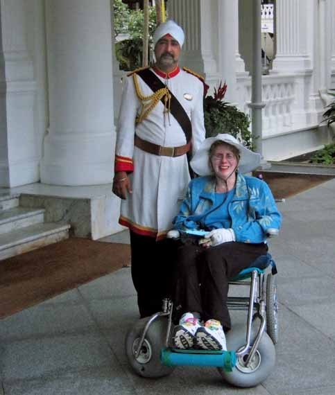 Nancy and Nate travel in wheelchair to Singapore